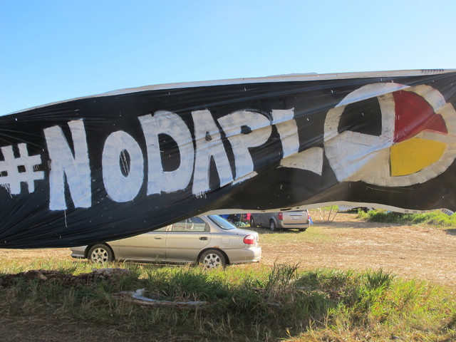 A banner protesting the Dakota Access oil pipeline is displayed at an encampment near North Dakota's Standing Rock Sioux reservation on Friday, Sept. 9, 2016. The Standing Rock Sioux tribe filed a ...