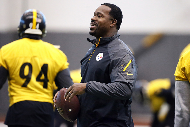 In this Jan. 13, 2016, file photo, Pittsburgh Steelers assistant coach Joey Porter runs a drill during the NFL football teams' practice in Pittsburgh. (Gene J. Puskar, File/AP)