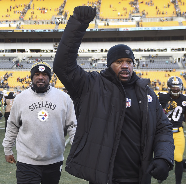 In this  Jan. 8, 2017 photo, Pittsburgh Steelers linebackers coach Joey Porter, right, and head coach Mike Tomlin leave the field after defeating the Miami Dolphins. (Christopher Horner/Tribune Re ...
