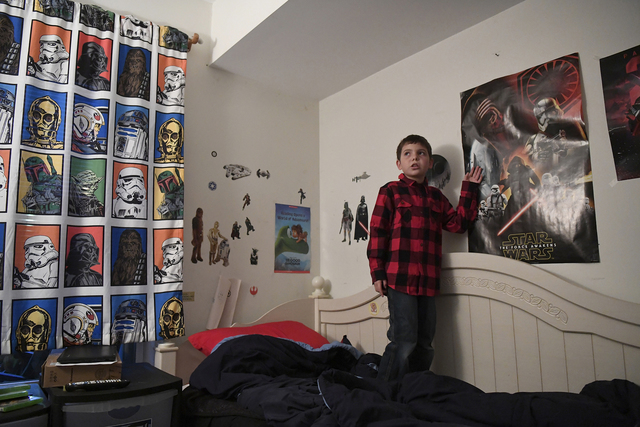 Joe Maldonado, 8, stands in his room in In this Dec. 13, 2016, file photo in Secauscus, New Jersey. Maldonado joined Pack 20 of Maplewood, New Jersey, on Tuesday. (Danielle Parhizkaran/Northjersey ...