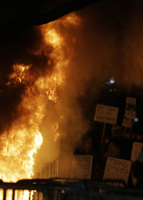 Protesters watch a bonfire on Sproul Plaza during a rally against the scheduled speaking appearance by Breitbart News editor Milo Yiannopoulos on the University of California at Berkeley campus on ...