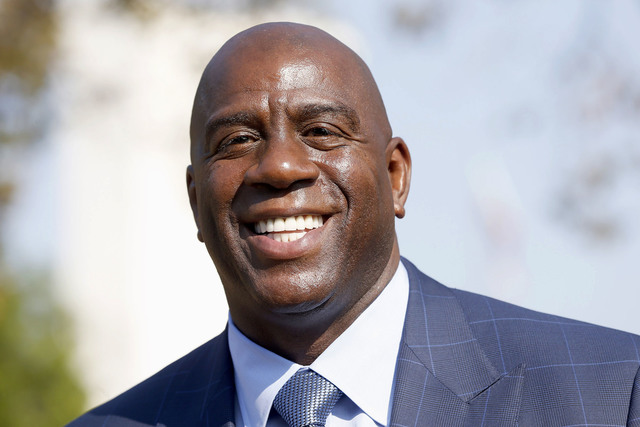 In this Aug. 23, 2016, file photo, former Los Angeles Lakers star Magic Johnson speaks at a groundbreaking ceremony for a stadium which will be home to the Los Angeles Football Club in Los Angeles ...