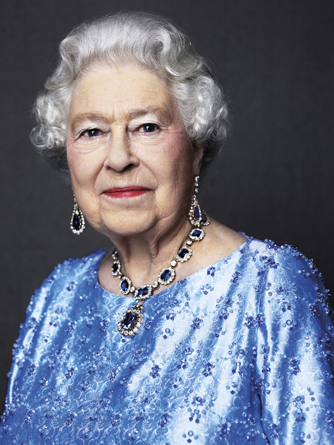 Queen Elizabeth II is wearing a suite of sapphire jewelry given to her by her father King George VI as a wedding gift in 1947. (David Bailey via AP)