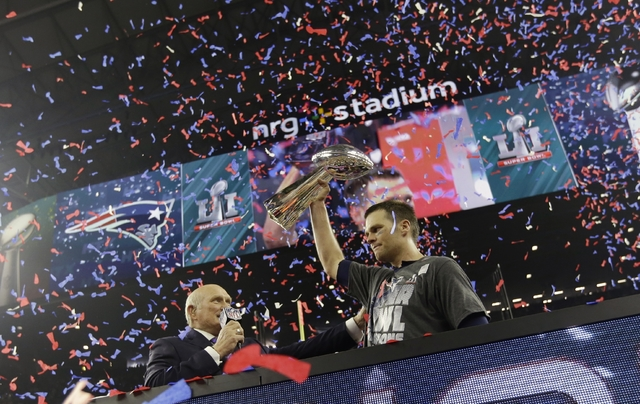 New England Patriots' Tom Brady hoists the Vince Lombardi Trophy after defeating the Atlanta Falcons in the NFL Super Bowl LI football game Sunday, Feb. 5, 2017, in Houston. The Patriots defeated  ...