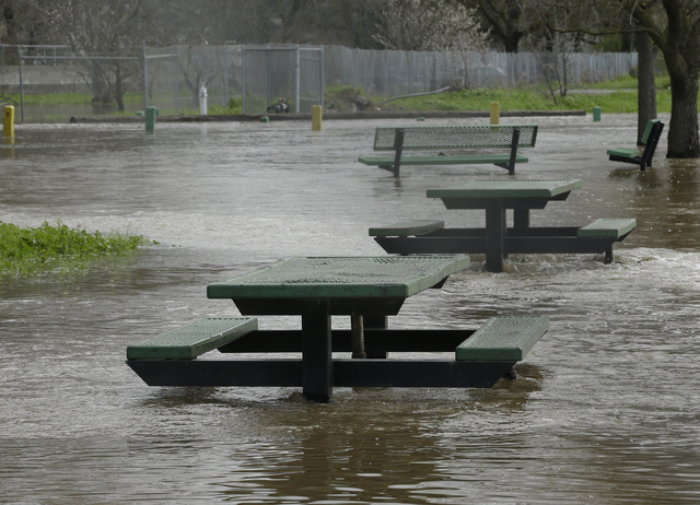Flood waters inundate a recreation area Tuesday, Feb. 21, 2017, in Rio Linda, Calif. Water overflowing from nearby Dry Creek caused officials to call for a voluntary evacuation for parts of the sm ...