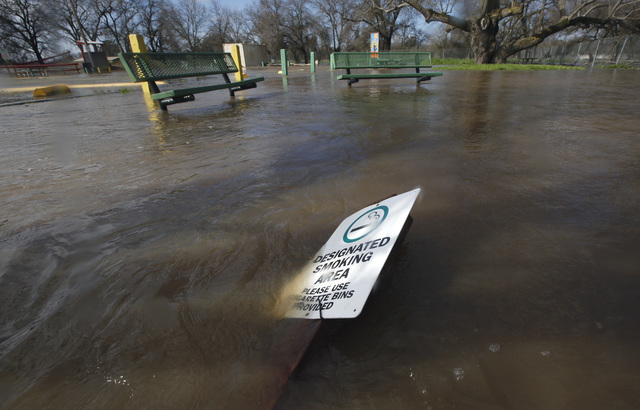 Flood waters inundate a recreation area Tuesday, Feb. 21, 2017, in Rio Linda, Calif. Water overflowing from nearby Dry Creek caused officials to call for a voluntary evacuation of parts of the sma ...