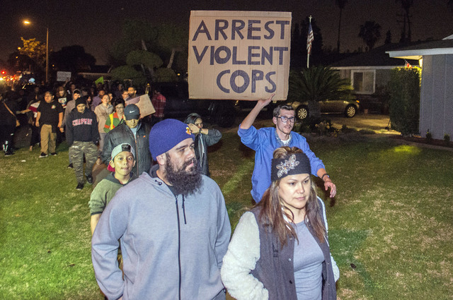 Protesters march toward an off-duty officer's home in Anaheim, California, Wednesday, Feb. 22, 2017.  (Joshua Sudock/The Orange County Register via AP)