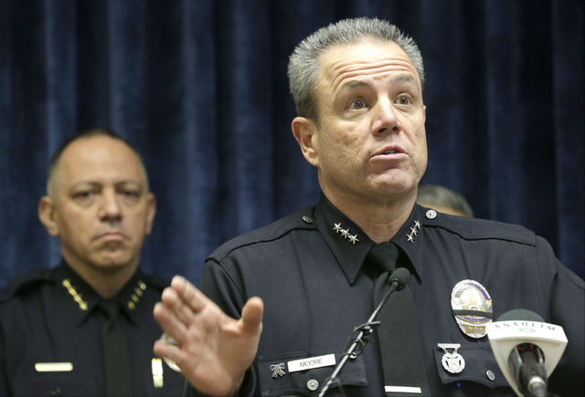 Anaheim Police Chief Raul Quezada, left, and Los Angeles Assistant Chief Michael Moore take questions at a news conference regarding a struggle between an off-duty California officer and a teenage ...