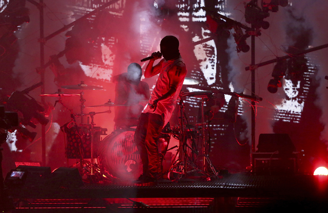 Twenty One Pilots perform a medley at the American Music Awards at the Microsoft Theater on Sunday, Nov. 20, 2016, in Los Angeles. (Matt Sayles/Invision/AP)