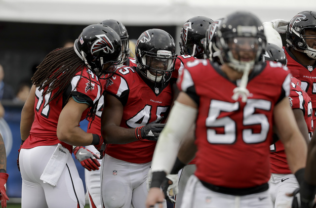 Atlanta Falcons middle linebacker Deion Jones (45) celebrates after scoring a touchdown on an interception against the Los Angeles Rams during the first half of an NFL football game Sunday, Dec. 1 ...