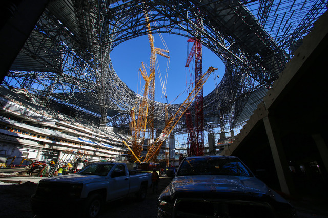 In this photo taken Friday, Dec. 2, 2016, construction of the new Mercedes Benz Stadium for the Atlanta Falcons continues in Atlanta. The Georgia Dome, which in 1992 became the Atlanta Falcons' ho ...