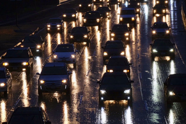 Early morning rush hour traffic crawls along the Hollywood Freeway near downtown Los Angeles on Thursday, Jan. 12, 2017. Flooded roads and freeways along with low fog and clouds made for a hazardo ...