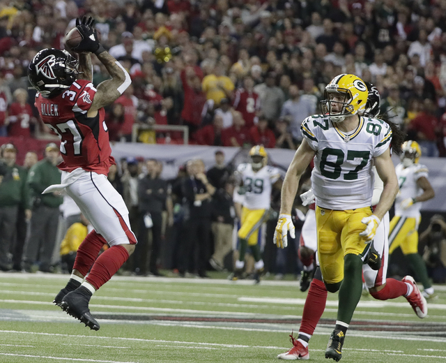 Atlanta Falcons' Ricardo Allen intercepts a pass in front of Green Bay Packers' Jordy Nelson during the first half of the NFL football NFC championship game Sunday, Jan. 22, 2017, in Atlanta. (Mar ...