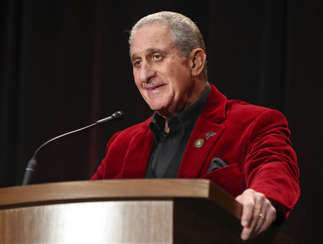 Atlanta Falcons owner Arthur Blank chuckles while asked a question about his dancing, during his only media availability in Houston for the Super Bowl against the New England Patriots during a new ...