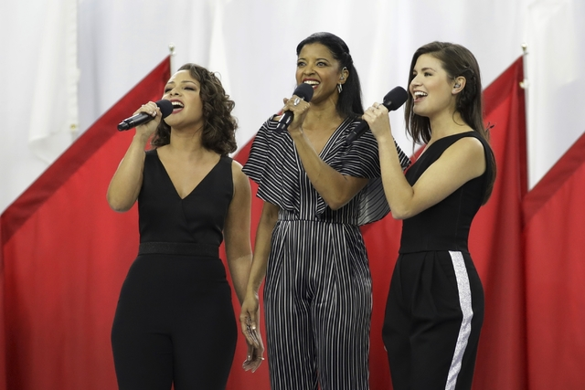 "Singers of the cast of Hamilton, Phillipa Soo, right, Rene Elise Goldsberry, center, and Jasmine Cephas Jones, sing ""God Bless America"", before the NFL Super Bowl 51 football gam ..."