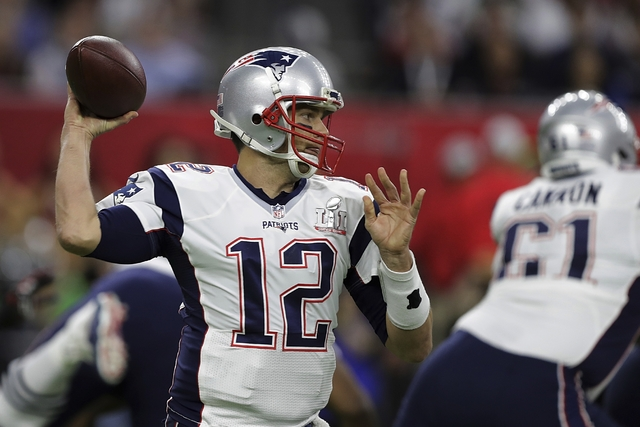 New England Patriots' Tom Brady looks to pass, during the first half of the NFL Super Bowl 51 football game against the Atlanta Falcons, Sunday, Feb. 5, 2017, in Houston. (AP Photo/Darron Cummings)
