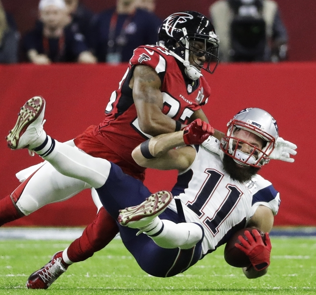 New England Patriots' Julian Edelman is tackled by Atlanta Falcons' Robert Alford during the first half of the NFL Super Bowl 51 football game Sunday, Feb. 5, 2017, in Houston. (AP Photo/Elise Ame ...