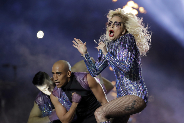 Singer Lady Gaga performs during the halftime show of the NFL Super Bowl 51 football game between the New England Patriots and the Atlanta Falcons, Sunday, Feb. 5, 2017, in Houston. (AP Photo/Patr ...