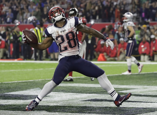 New England Patriots' James White celebrates after scoring a touchdown during the second half of the NFL Super Bowl 51 football game against the Atlanta Falcons, Sunday, Feb. 5, 2017, in Houston.  ...