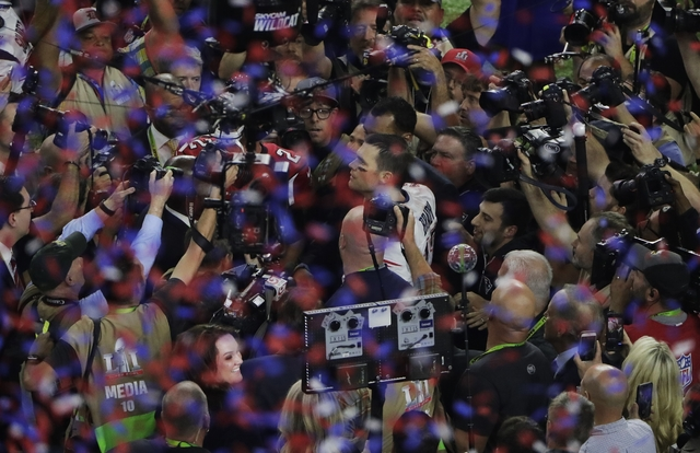 New England Patriots' Tom Brady celebrates after their overtime win in the NFL Super Bowl 51 football game against the Atlanta Falcons, Sunday, Feb. 5, 2017, in Houston. (AP Photo/Charlie Riedel)