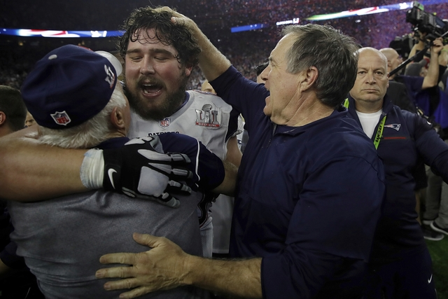 New England Patriots head coach Bill Belichick, right, congratulates David Andrews after defeating the Atlanta Falcons in overtime at the NFL Super Bowl 51 football game Sunday, Feb. 5, 2017, in H ...