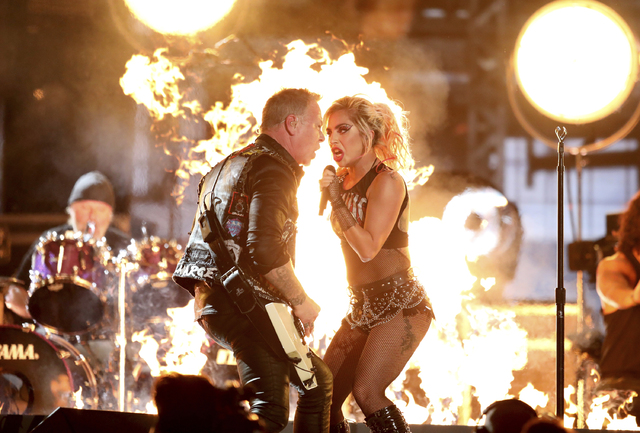"James Hetfield of Metallica and Lady Gaga perform ""Moth Into Flame"" at the 59th Annual Grammy Awards on Sunday, Feb. 12, 2017, in Los Angeles. (Matt Sayles/Invision/AP)"