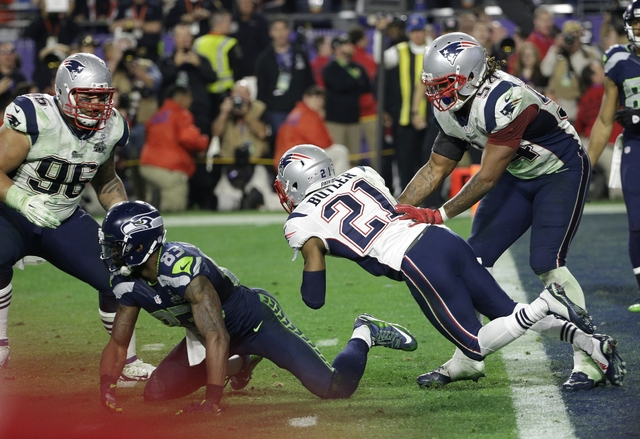 New England Patriots strong safety Malcolm Butler (21) intercepts a pass during the second half of NFL Super Bowl XLIX football game against the Seattle Seahawks Sunday, Feb. 1, 2015, in Glendale, ...