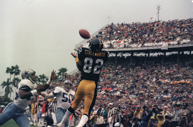 Pittsburgh Steelers wide receiver John Stallworth (82) goes high to haul in a pass from Terry Bradshaw and score the first Steeler touchdown against the Dallas Cowboys in the first quarter of Supe ...