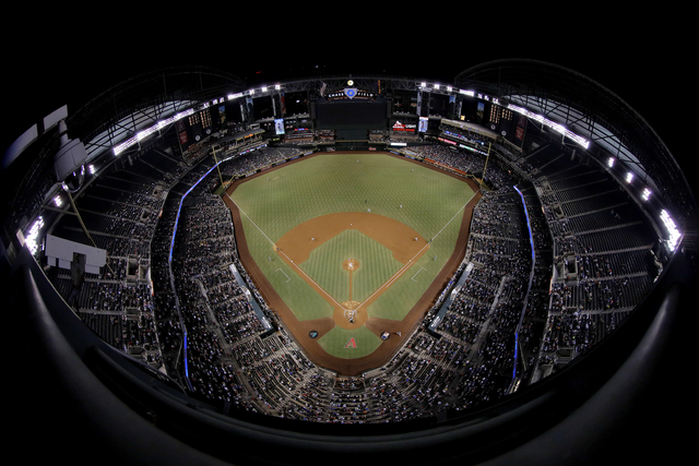 The Los Angeles Dodgers and the Arizona Diamondbacks play during the third inning of a baseball game, Thursday, Sept. 15, 2016, in Phoenix. (AP Photo/Matt York)