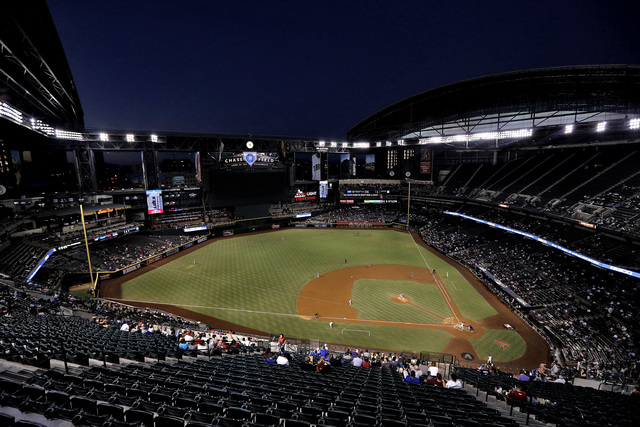 The Los Angeles Dodgers and the Arizona Diamondbacks play during the second inning of a baseball game, Thursday, Sept. 15, 2016, in Phoenix. (AP Photo/Matt York)