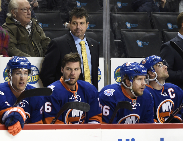 FILE - In this Nov. 8, 2015, file photo, New York Islanders coach Jack Capuano looks toward the ice during the first period of the team's NHL hockey game against the Boston Bruins in New York. It& ...