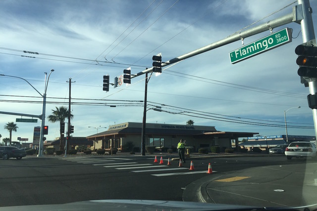 A girl was struck by a truck in the intersection of South Sandhill and East Viking roads about 2:45 p.m. on Wednesday, Feb. 8. (Blake Apgar/Las Vegas Review-Journal)