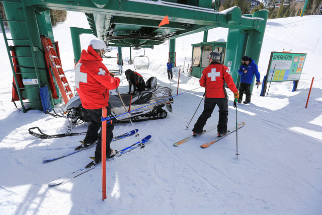 Snow Safety Manager Greg French, 52, left, and Ski Patrol Manager Michelle French, 56, right, along with nearly two-year-old Lida, sitting on the snow mobile, get ready for a training exercise at  ...