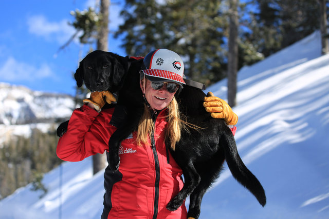 Ski Patrol Manager Michelle French carries 2-year-old avalanche rescue dog Lida after a training exercise at Lee Canyon ski resort on Mount Charleston on Thursday, Feb. 23, 2017, in Las Vegas. Dur ...