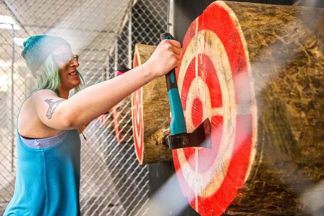 Miranda Boyd removes axes from a wooden target at Axe Monkeys Vegas on Wednesday, Feb. 1, 2017, in Las Vegas. (Benjamin Hager/Las Vegas Review-Journal) @benjaminhphoto