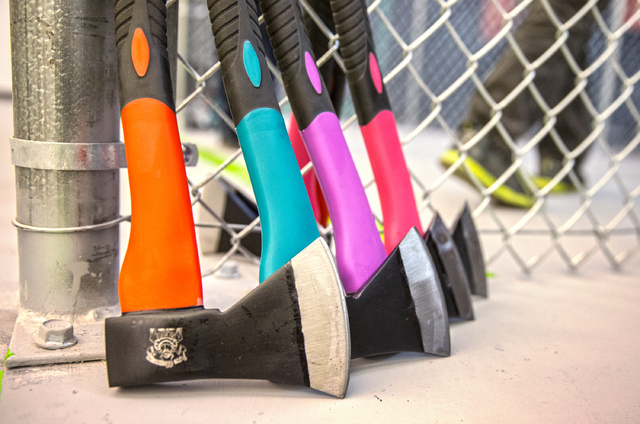 Each lane at Axe Monkeys Vegas is stocked with colorful throwing axes of all shapes a sizes. Photo taken on Wednesday, Feb. 1, 2017, at Axe Monkeys Vegas, in Las Vegas. (Benjamin Hager/Las Vegas R ...
