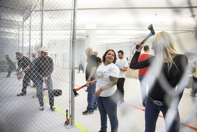 Instructor Erica Jensen, middle, gives throwing tips to Lydia Ansel, right, at Axe Monkeys Vegas on Wednesday, Feb. 1, 2017, in Las Vegas.  (Benjamin Hager/Las Vegas Review-Journal) @benjaminhphoto