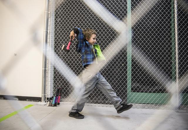 Zachary Pruit, 10, practices throwing axes at Axe Monkeys Vegas on Wednesday, Feb. 1, 2017, in Las Vegas.  (Benjamin Hager/Las Vegas Review-Journal) @benjaminhphoto