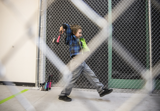 Zachary Pruit, 10, practices throwing axes at Axe Monkeys Vegas on Wednesday, Feb. 1, 2017, in Las Vegas.  (Benjamin Hager/Las Vegas Review-Journal) @benjaminhphoto