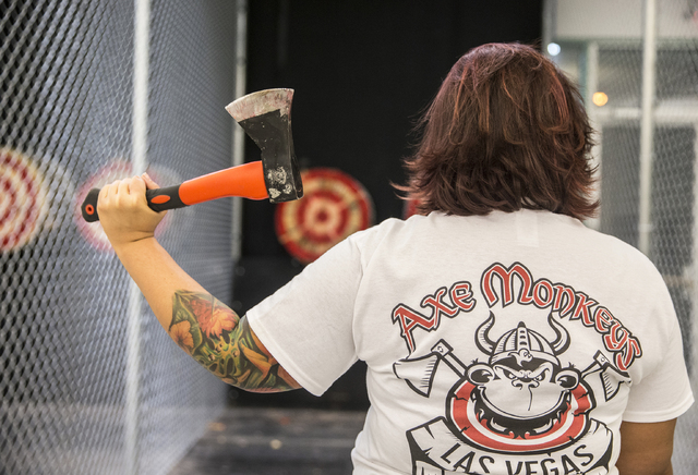 Instructor Erica Jensen eyes up her target at Axe Monkeys Vegas on Wednesday, Feb. 1, 2017, in Las Vegas. (Benjamin Hager/Las Vegas Review-Journal) @benjaminhphoto