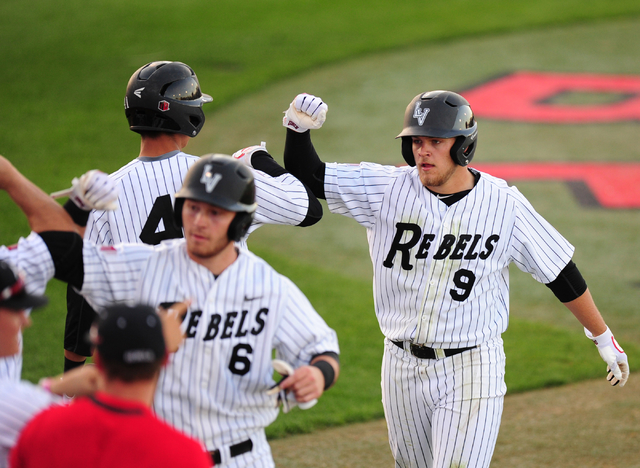 Nick Rodriguez, rear left, shown in March, had a double and a single and scored twice for UNLV on Friday in its 6-1 home win over No. 7-ranked Cal State Fullerton. (Josh Holmberg/Las Vegas Review- ...