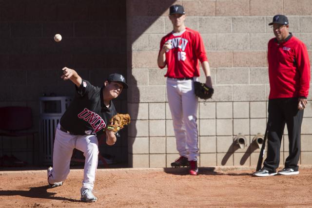 UNLV's pitcher Paul Richy (43) throws the ball during a baseball team practice at Earl E. Wilson Stadium on Tuesday, Feb. 14, 2017, in Las Vegas. (Erik Verduzco/Las Vegas Review-Journal) @Erik_Ver ...