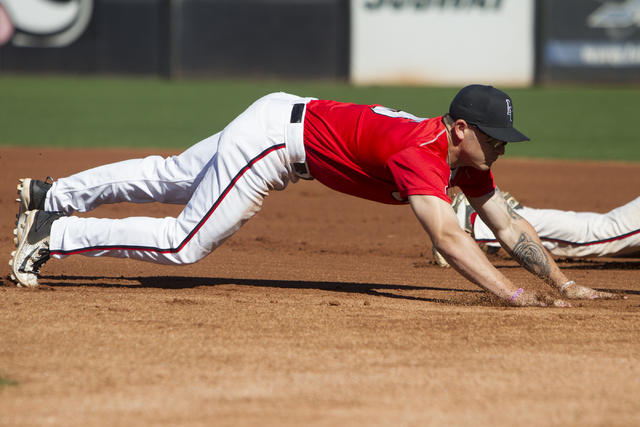 UNLV's Kyle Isbel (5) slides to first base during a baseball team practice at Earl E. Wilson Stadium on Tuesday, Feb. 14, 2017, in Las Vegas. (Erik Verduzco/Las Vegas Review-Journal) @Erik_Verduzco