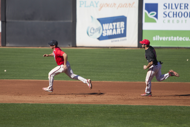 UNLV's Justin Jones (2), left, and Grant Robbins (27) run the bases during a team practice at Earl E. Wilson Stadium on Tuesday, Feb. 14, 2017, in Las Vegas. (Erik Verduzco/Las Vegas Review-Journa ...