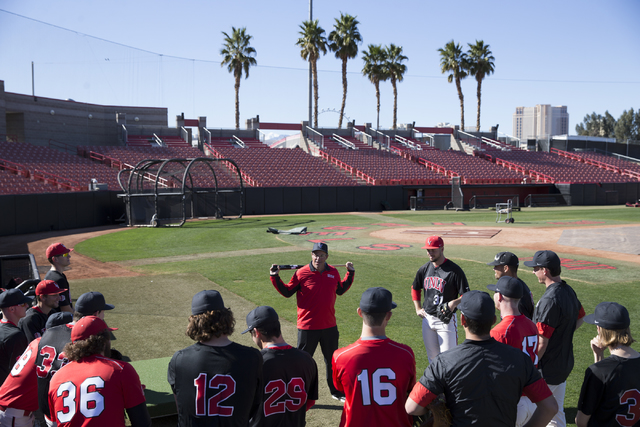 UNLV's pitching coach Greg Maddux, center, speaks to his players during a baseball team practice at Earl E. Wilson Stadium on Tuesday, Feb. 14, 2017, in Las Vegas. (Erik Verduzco/Las Vegas Review- ...