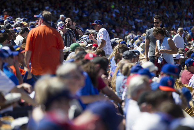 Fans watch the Chicago Cubs play against the New York Mets in their baseball game during Big League Weekend at Cashman Field on Friday, March 1, 2016, in Las Vegas. The Mets won 8-1. (Erik Verduzc ...