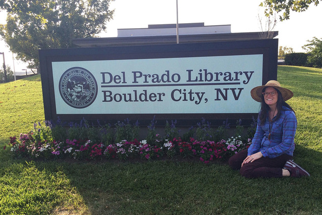 "Assistant prop master Kim Richey poses on ""La La Land's"" Boulder City set in Santa Clarita, Calif. The library was named after the street on which the Boulder City native gre up. ..."