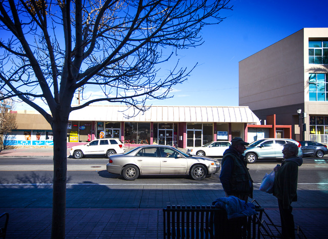 People wait for a bus on Water Street in Henderson. City officials and businesses are trying to remake the downtown corridor.  (Jeff Scheid/Las Vegas Review-Journal)