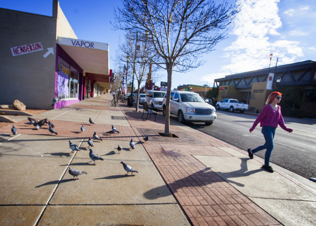 A young woman walks on Water Street in Henderson. City officials and businesses are trying to remake the downtown corridor. (Jeff Scheid/Las Vegas Review-Journal)