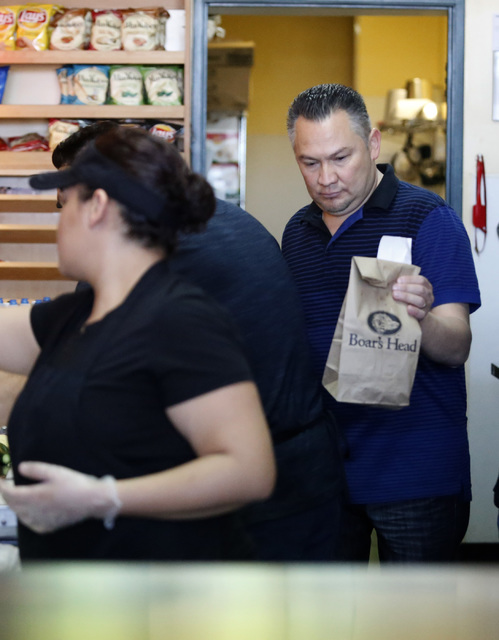 Luis Escobar, 42, right, brings a customer their to-go order at the George's Italian Deli on Friday, Feb. 3, 2017, in Las Vegas. Escobar is the owner of the deli. (Christian K. Lee/Las Vegas Revie ...